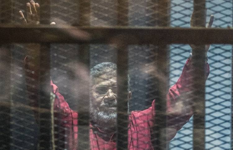 Egypt former president Morsi dies after collapsing in court