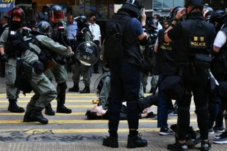 Police shoot protester, man set alight in day of Hong Kong fury