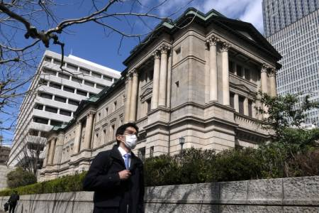 Bank of Japan expands easing measures, cuts growth forecast